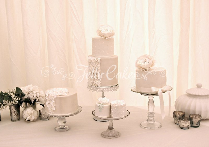 white ruffles wedding cake table