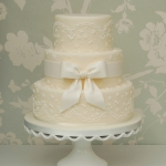 ivory-lace-and-bow-wedding-cake-8